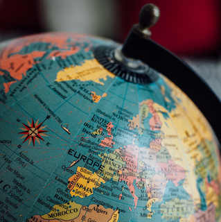 Europe on a globe (Photo by Tom Grimbert (@tomgrimbert) on Unsplash)